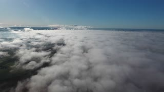 videoblocks-drone-shot-flying-over-clouds-high-altitude-in-south-of-france-mediterranean-sea-in-background_Buev1J-fs7